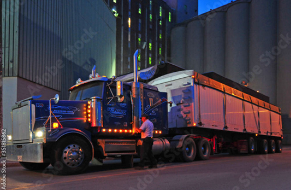 A commercial truck driving on a road